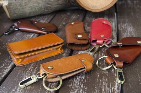 key in chain: Leather key holder on wooden background