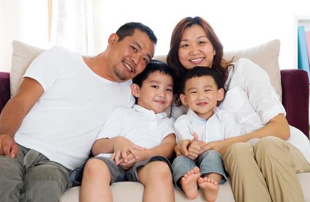 Portrait of asian family sitting on sofa