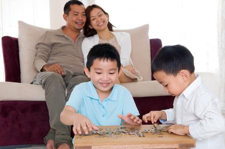 asian coins: Asian boys cointing coins. Money saving concept.