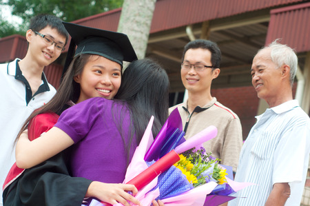 graduation gown: Asian university student and family celebrating graduation