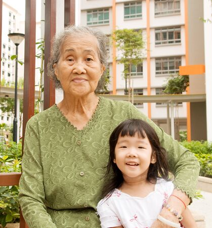 chinese people: outdoor portrait of a senior woman with her granddaughter Stock Photo
