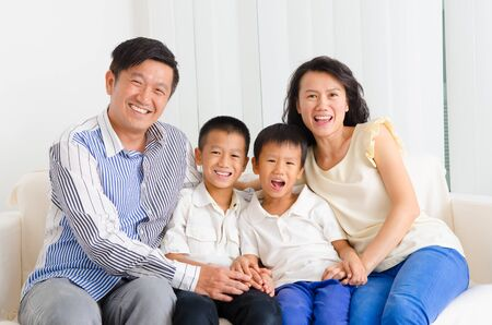 Indoor portrait of asian family photo