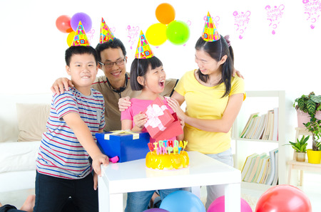 southeast asian: Asian family enjoying birthday party at home