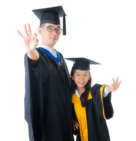 asian family: Asian father and daughter in graduation gown and making okay sign