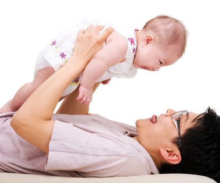 asian baby girl: Asian father picking up his 6 months old daugther Stock Photo