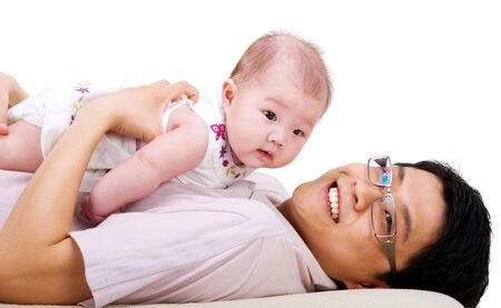 six months: Portrait of asian father and his six months old baby girl