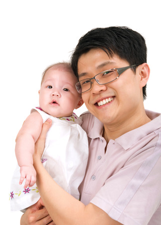 six months: Asian father and his six months old baby girl Stock Photo