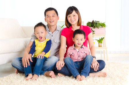 Beautiful asian family sitting on the floor
