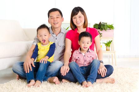 Beautiful asian family sitting on the floor