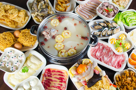chinese style hot pot soup with wide variety of ingredients Stock Photo