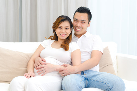 pregnant woman with husband: Indoor portrait of beautiful asian pregnant woman and her husband