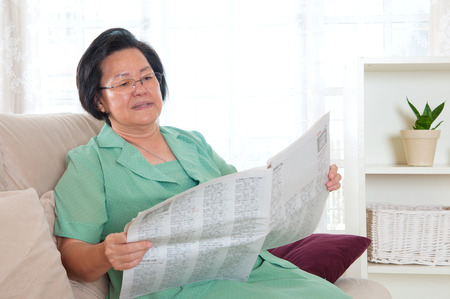 asian lady: Asian senior woman reading newspaper