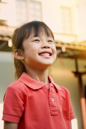 child laughing: Beautiful asian child