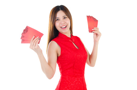 red packet: Cheerful asian woman in traditional chinese costume, cheongsam holding red packet. Chinese new year concept.
