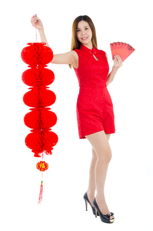 red packet: Asian woman in traditional chinese costume holding lantern and red packet Stock Photo