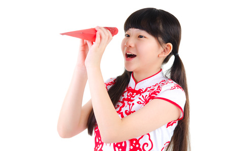red packet: Asian girl looking into the red packet with surprise expression. Chinese new year concept.