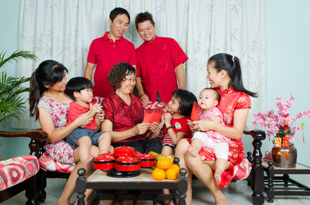 celebrate year: Asian three generations family celebrating chinese new year Stock Photo