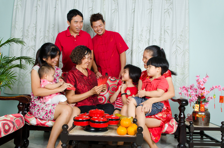 three wishes: Asian three generations family celebrating chinese new year Stock Photo