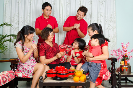 three generations: Asian three generations family celebrating chinese new year Stock Photo