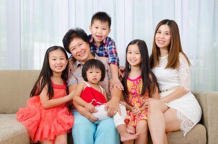 three generations of women: Indoor portrait of asian senior woman together with her daughter and grandchildren
