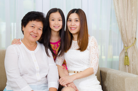 Indoor portrait of asian senior woman together with daughter and grandchild