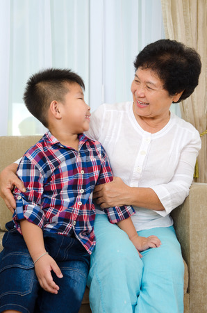 grandkid: Indoor portrait of asian senior woman and grandchild