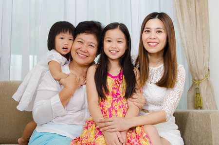 young asian: Indoor portrait of asian senior woman together with daughter and grandchildren