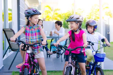 asia children: Asian kids enjoying cycling
