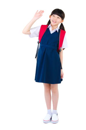 waive: Cute asian primary student waive her hand