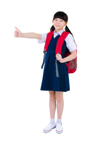 asian children: Cheerful asian primary student raised her thumbs up Stock Photo
