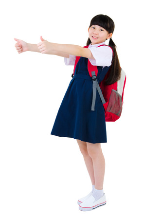 school bags: Asian primary student raised her thumbs up Stock Photo