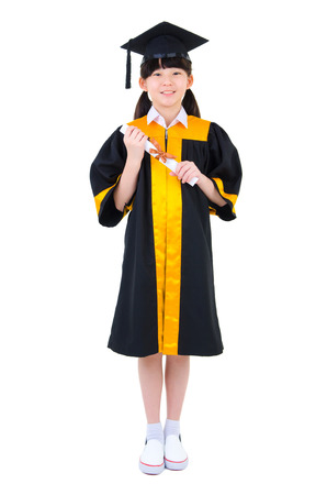 Cheerful asian child in graduation gown holding certificate isolated on white background