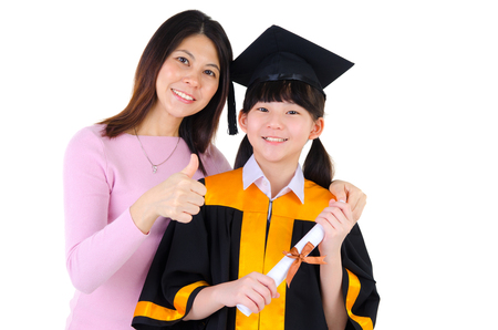 mortarboard: Asian girl in graduation gown and mortarboard together with mother Stock Photo