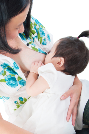 breastmilk: Portrait of asian mother breastfeeding her baby