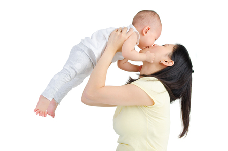 Asian mother lifting up her baby
