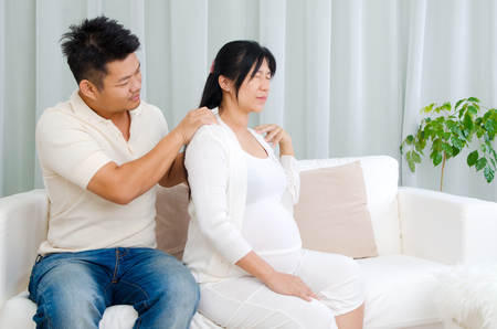 suffered: Asian husband massage for his pregnant wife who suffered shoulder pain