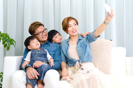 asian family home: Asian family taking selfie at home
