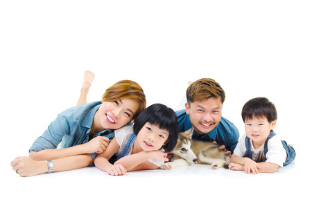 Portrait of asian family and their pet on white background Stock Photo