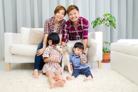 asian boy: Asian family having fun in the living room
