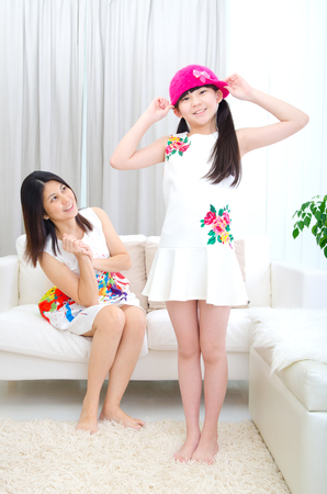 mum and daughter: Asian mother looking at her daughter