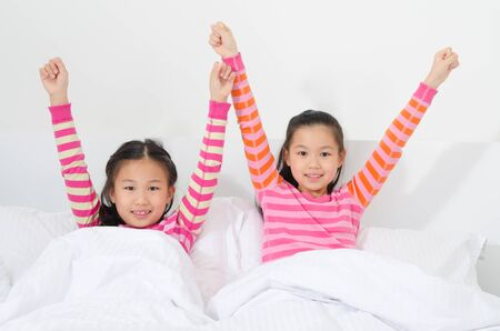 stretch: Asian kids wake up in the morning Stock Photo