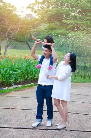 Asian family having morning walk in the beautiful sunshine Standard-Bild