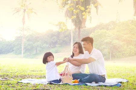 Asian family enjoying outdoor nature