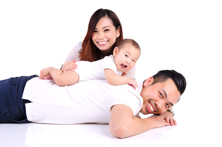 six months: Asian parent playing with their six months old baby boy