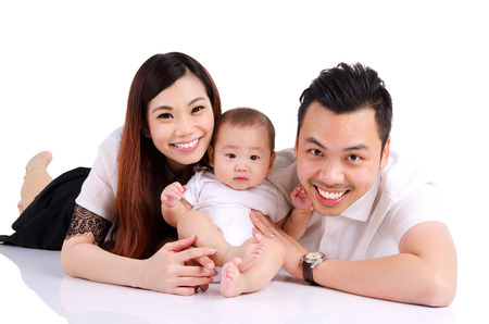 six months: Portrait of asian parent and their six months old baby boy