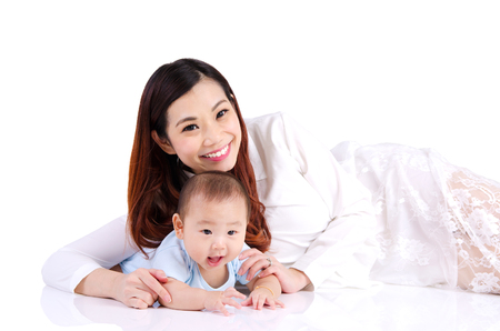 six months: Asian woman and her six months old baby boy lying on the floor