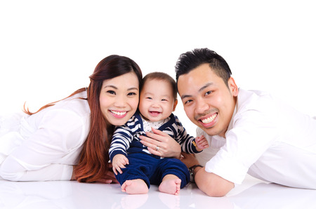 a young baby: Asian parent and their six months old cheerful baby