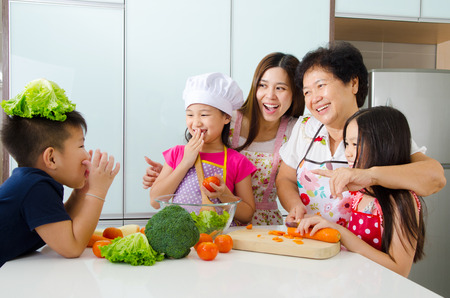 home cooking: Asian three generations family enjoyed cooking in the kitchen