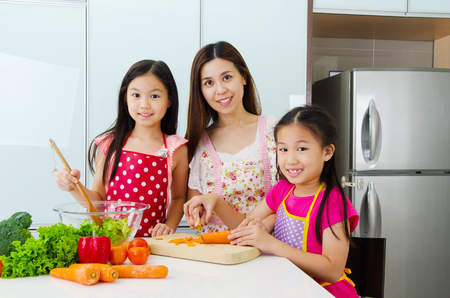 enjoyed: Asian mother and kids enjoyed cooking in the kitchen
