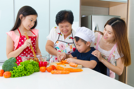 enjoyed: Asian three generations family enjoyed cooking in the kitchen
